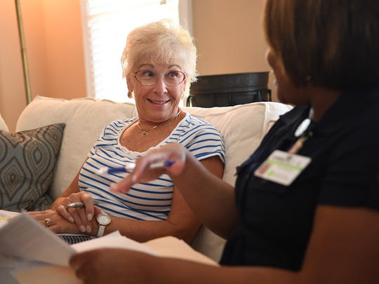 Ruth Benson, left, speaks with Kimberly Mattison, a Greenville Health System Alzheimer Caregiver Coach, about stress and relaxation at Benson's home Tuesday. Ruth has been caring for her husband Bob, who has dementia.