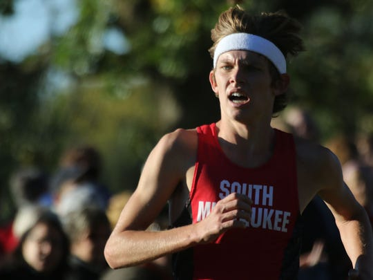 South Milwaukee's Jordan Janusiak nears the finish line at the Woodland Conference meet in 2016 at Hales Corners Park. Janusiak won the event, then took eighth at the state meet.