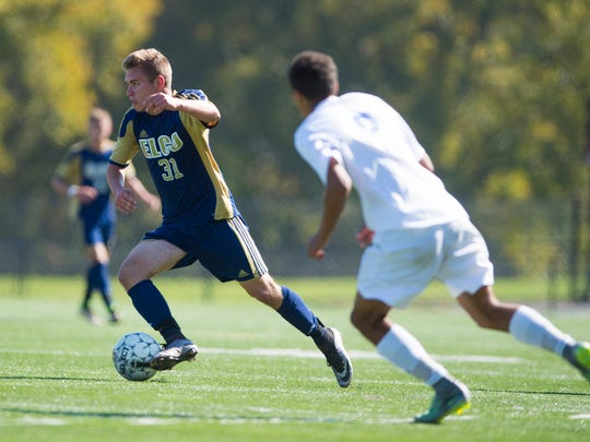 Elco's Evan Gettler looks for room as Elco fell to