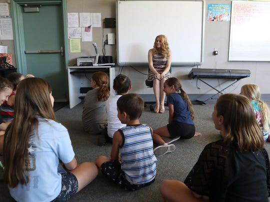 University Preparatory School alumna Rebecca Gilbert, center, talks with members of this year's Kids Unlimited Thursday at  Sequoia Middle School. Gilbert is a student at the American Musical Dramatic Academy in Los Angeles.