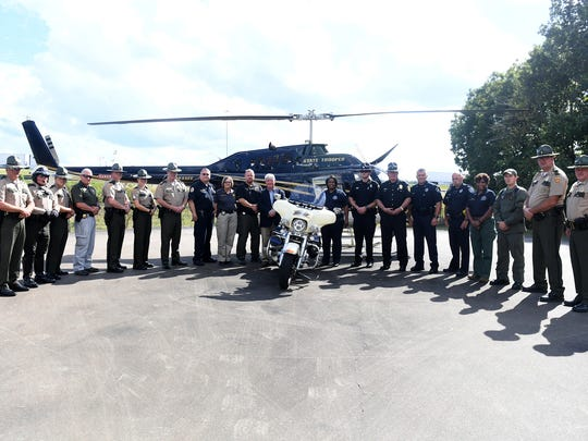 West Tennessee Law Enforcement agencies pose for a photo at the Tennessee Highway Patrol Jackson Office before heading out to take part in the distracted driving bus tour, Monday, October 9.