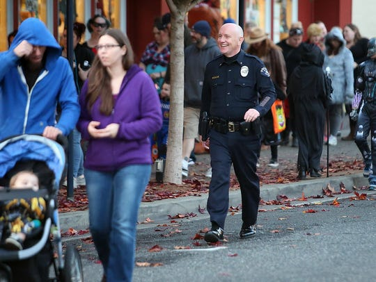 Bremerton Police Chief Steve Strachan takes part in the Bremerton Trick or Treat Street in October.