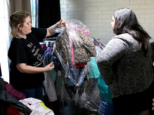 Shannon Turnbo (left) packages a donated jacket and