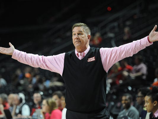 Coach Broadhead honoring breast cancer survivors by wearing pink