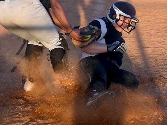 West Carroll High School's Ashley Barlow slides safely to home plate during a game against Peabody, Monday, April 30.