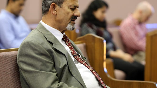 Dr. Raouf Ghattas prays during service at Arabic Baptist Church in Murfreesboro.