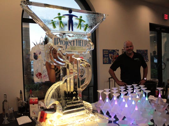 Project Help's ice sculpture which was one of the favorite attractions of the night. Bartenders would pour drinks into the fountain, which would then cool the liquor on its way into guests glasses.