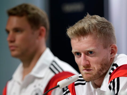 German national soccer player Andre Schuerrle, foreground right, attends a news conference besides teammate goalkeeper Manuel Neuer in Santo Andre near Porto Seguro, Brazil, Wednesday, July 2, 2014. Germany faces France on upcoming Friday in Maracana Stadium in Rio de Janeiro, in the quarterfinals of the World Cup. (AP Photo/Matthias Schrader)