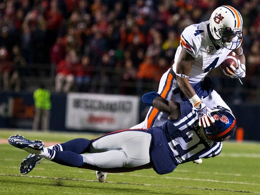 10ThingstoSeeSports - Mississippi defensive back Senquez Golson (21) tackles Auburn wide receiver Quan Bray (4) during the second half of an NCAA college football game Saturday, Nov. 1, 2014, in Oxford, Miss. (AP Photo/Brynn Anderson, File)