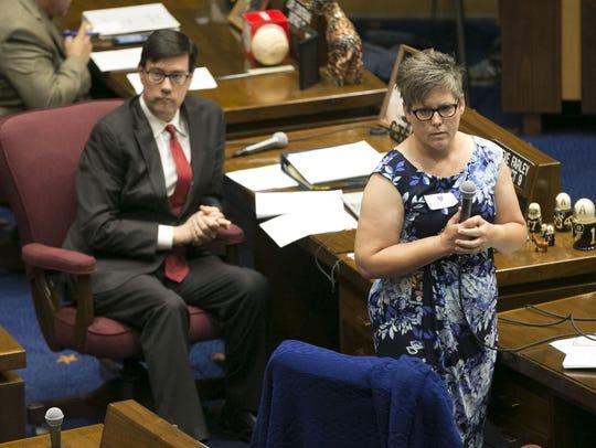 Sen. Katie Hobbs speaks as Sen. Steve Farley listens