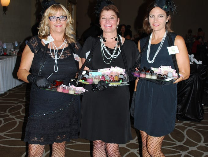 Lemongrass Spa sponsors, Darlene Winant-Ekdahl, Kathy Lowery and Kathy Deane, attend the Giving Hope Gala on Sept. 6 at Hilton Melbourne Rialto. Proceeds benefit the Salvation Army in Melbourne.