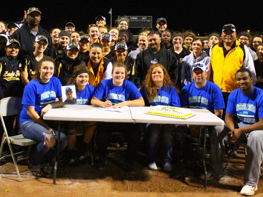 Alamogordo senior Breanna Jacob, front center, signed her letter of intent to Western Texas College on Friday night.