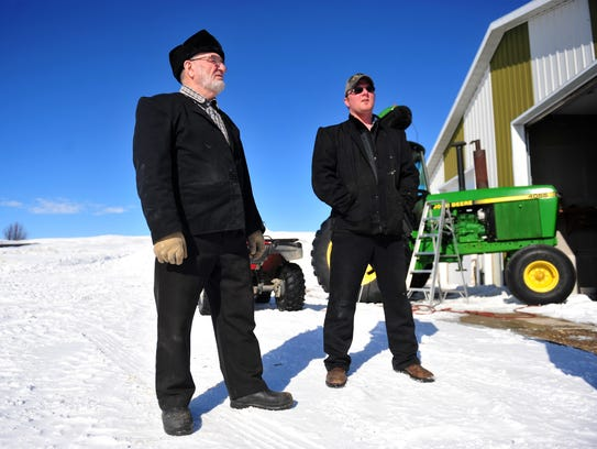 Dan Wurz, left, and Jason Wurz of the Glacier Hutterite Colony, north Cut Bank, talk about the challenges posed by weather this winter.