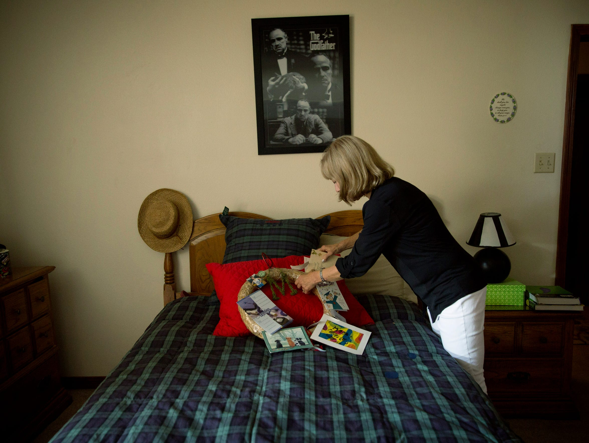 Debbie Milam places a card she found on the bed of