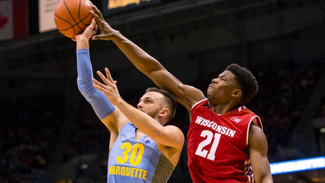 Badgers guard Khalil Iverson blocks Golden Eagles guard Andrew Rowsey's shot during a December meeting between Wisconsin and Marquette at the BMO Harris Bradley Center.