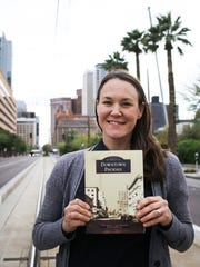 Jill Johnson poses with the book, Downtown Phoenix