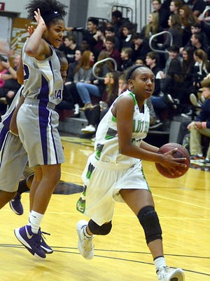 Station Camp High sophomore LaPraysia Ward drives toward the basket during second-quarter action. Ward scored five points in the Lady Bison's 59-58 victory.