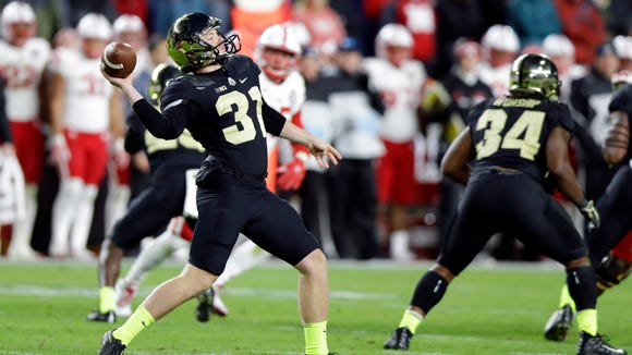 Purdue punter Joe Schopper (31) throws a pass on a fake punt against Nebraska during the second half of an NCAA college football game in West Lafayette, Ind., Saturday, Oct. 28, 2017. (AP Photo/Michael Conroy)