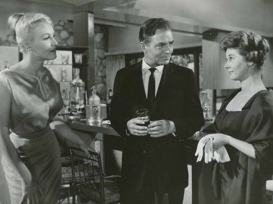 Julie Newmar, on the left, with James Mason and Susan Hayward in the 'Marriage-Go-Around'.