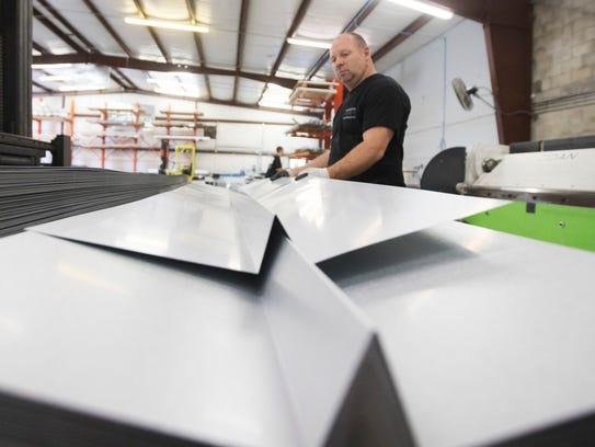 Scott Skinner, an employee of Architectural Metal Flashings