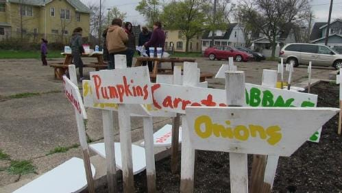 Signs showing the bounty to be had a the Post-Franklin Community Garden in 2015.
