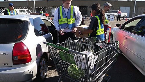 Volunteers load up cars with turkey dinners at St. Mary's Food Bank on Nov. 23, 2016.