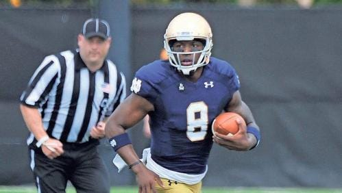 In this April 18 file photo, Notre Dame quarterback Malik Zaire (8) runs during the Blue Gold NCAA college football game in South Bend, Indiana.