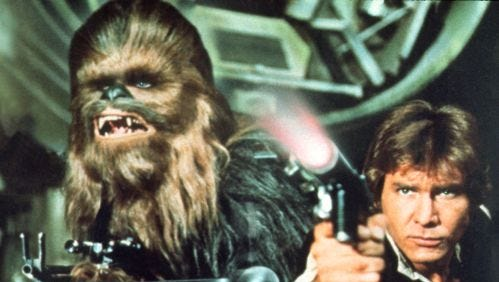 "File photo shows Peter Mayhew as Chewbacca and Harrison Ford as Han Solo in a scene from the motion picture ""Star Wars Episode IV - A New Hope."" Christopher Williams wore a Chewbacca mask during the robbery, courthouse records show."