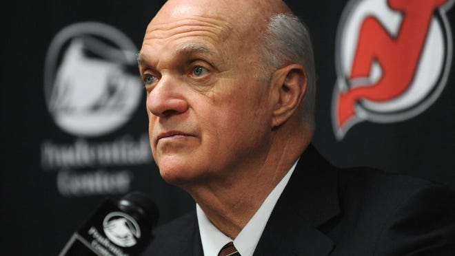 In this Jan. 8, 2010, file photo, Lou Lamoriello talks to the media after a New Jersey Devils game.