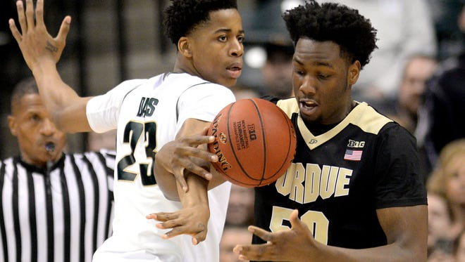 Michigan State nearly had Deyonta Davis, left, and Caleb Swanigan, right, in the same frontcourt. And had Swanigan stayed with his commitment to MSU, they might both have been on this year's team.