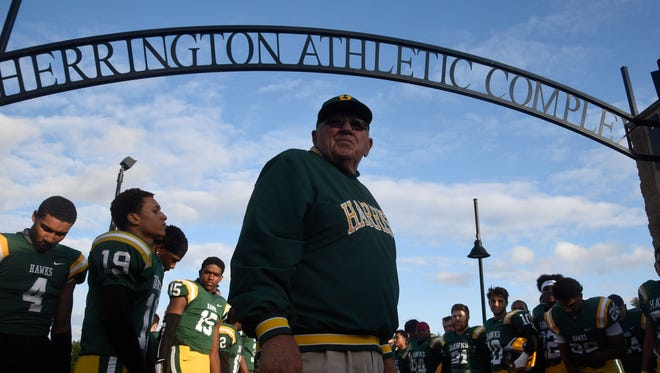 Harrison High School dedicated the entrance arch to longtime Harrison football coach John Herrington before the start of the Hawks game against Stoney Creek Friday, Sept. 8.
