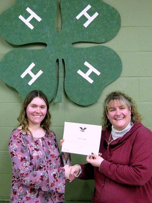 Chemung County 4-H member Ashley Schultz, left, shows off her President's Volunteer Service Award with 4-H Resource Educator Bernadette Raupers.