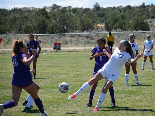 Carlsbad's Emma Haston keeps the ball in play against