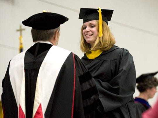 Fond du Lac's Jeanna (Giese) Frassetto accepts her diploma at Lakeland College near Sheboygan.