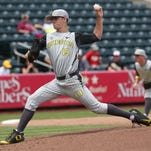 The Oregon Ducks' Cole Irvin pitches against the Iowa Hawkeyes during NCAA Regional Baseball action from Hammons Field in Springfield, Missouri on May 29, 2015