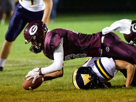 Genoa's Josiah Bradfield rushed for four touchdowns Friday. He also recovered this fumble.