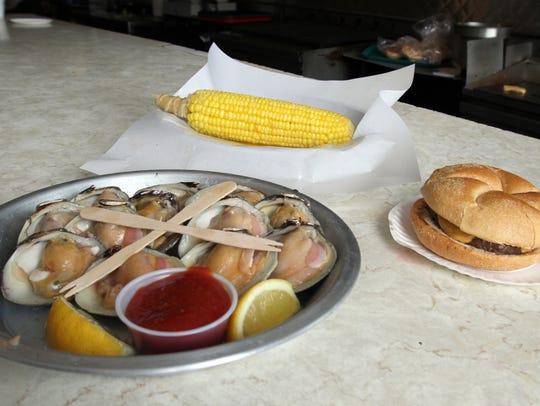 Raw clams, corn on the cob and a cheeseburger at Leno's