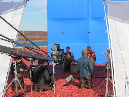 Actors Justin, left, and Henry, right, film an Ocean Spray commercial in Warrens.