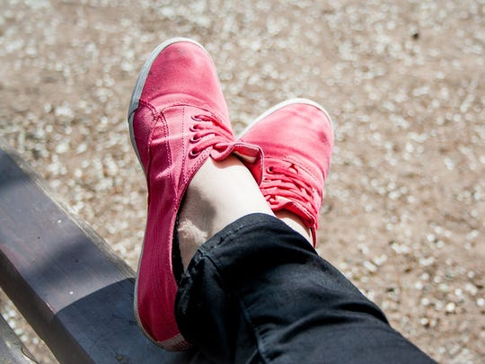 Canvas sneakers can be a fun, comfortable way to add color to your summer outfit.