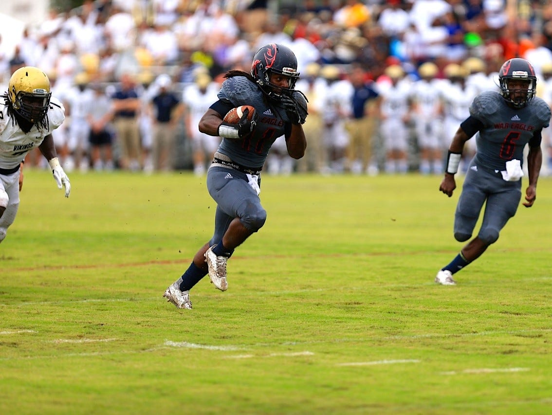 Wakulla running back Demarcus Lindsey rushes for a 24-yard touchdown in the first quarterback of the War Eagles' game against Spartanburg.