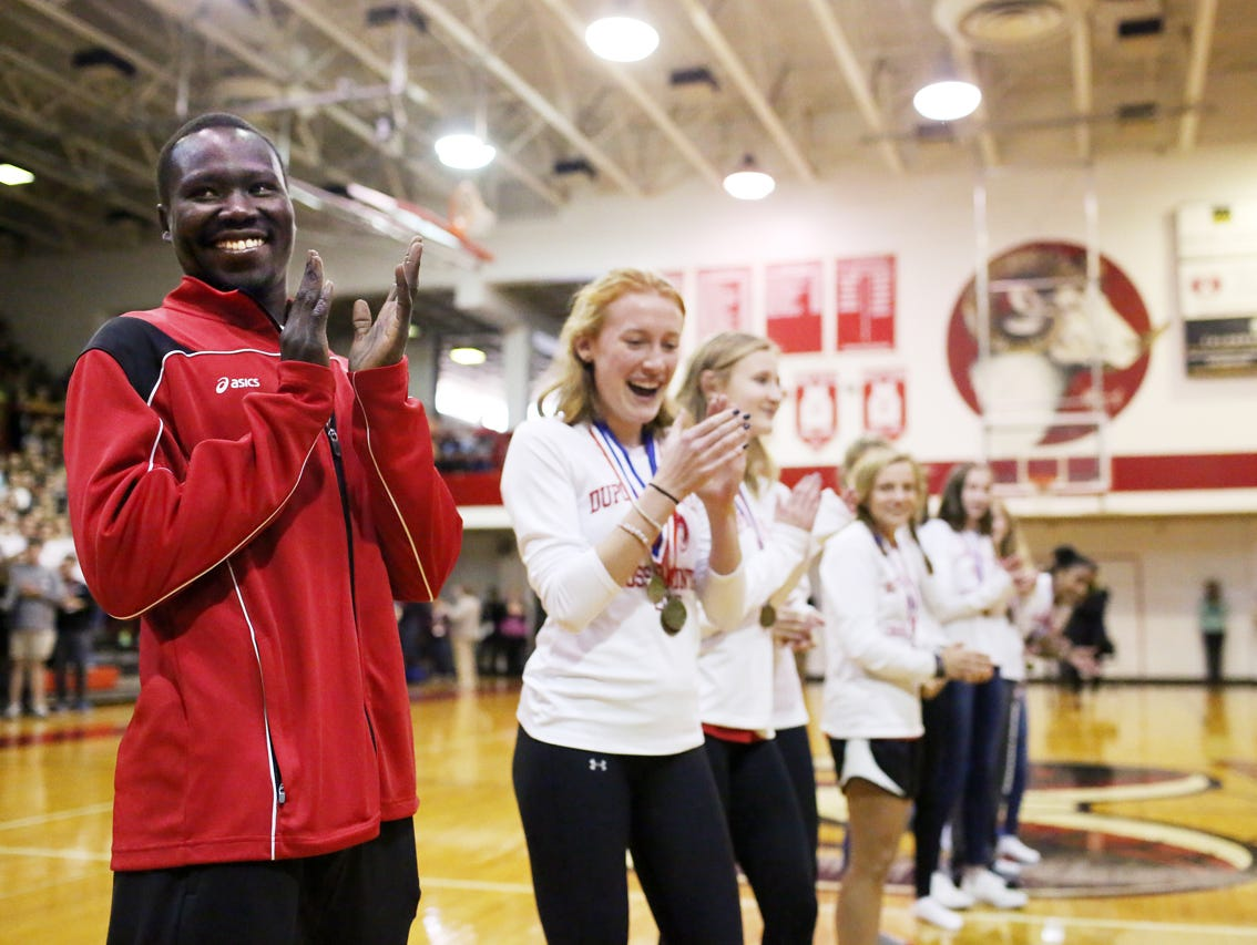 Rizik Lado, assistant cross country coach at duPont Manual High School, celebrates the recent cross country state championship with team members at a Pep Rally. November 9, 2016