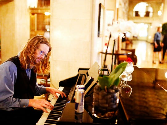 Brad Tomlinson performs for diners at The Brown Hotel Lobby Bar. Tomlinson has been playing at the hotel's bar six nights a week for the last year. April 25, 2017Tyler Bissmeyer/Special to The C-J