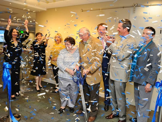 Confetti flies in November 2017 after the ribbon-cutting for the grand opening of the Patty and Bob Hendrickson Imagine Room at the Maltz Jupiter Theatre, part of the Believe capital campaign. Pictured are, from left, Claire Trehan, the theater's grant writer; Laura Cole, development administrative associate; Pam Dyar, director of development; Patty and Bob Hendrickson; Andrew Kato, producing artistic director and chief executive; Jupiter Mayor Todd Wodraska; and Jeanne Ford, executive vice president and COO of the Palm Beach North Chamber of Commerce.