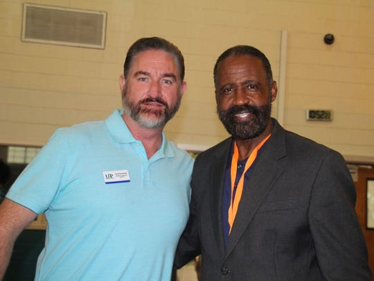 Ron Browning, of United Against Poverty, and Freddie Woolfork, Gifford Youth Achievement Center director of public relations and facilities operations, at the Gifford Job Fair.