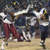 Sunnyside's Aaron Mouton, right, gets by Tulare Union's Xavier Alexander during Friday's Central Section Division II quarterfinal game at Bob Mathias Stadium. Sunnyside won 46-14.