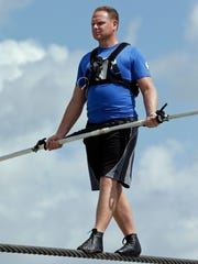 In this June 18, 2013 file photo, high wire performer Nik Wallenda practices in Sarasota, Fla. Five circus performers were seriously injured Wednesday, Feb. 8, 2017, while practicing a high-wire act in Florida. The accident involved  Wallenda and several members of his family. Authorities say Wallenda was not injured. (AP Photo/Chris O'Meara, File)