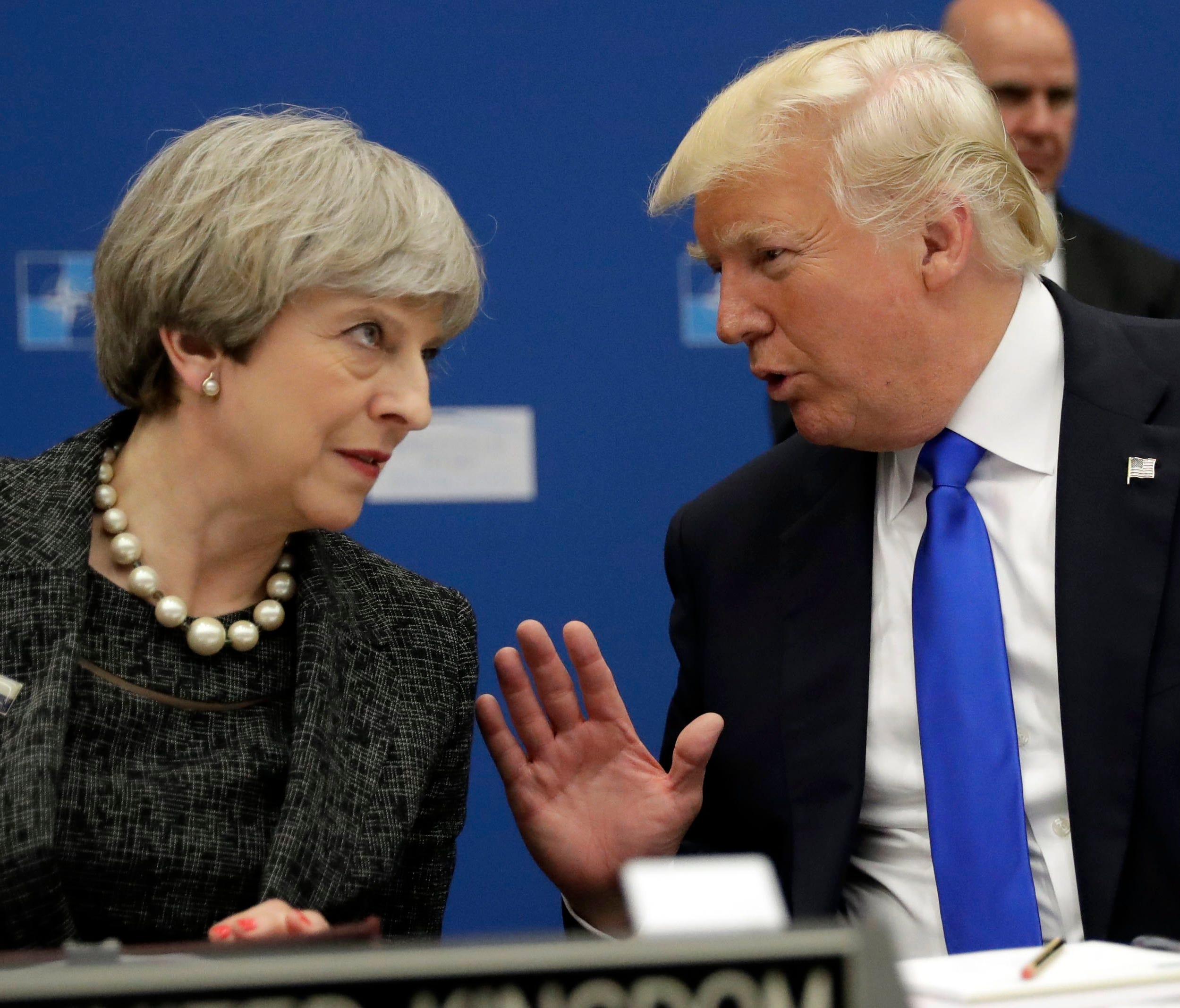 President Trump and British Prime Minister Theresa May speak during a working dinner meeting at the NATO summit in Brussels, Belgium, May 25, 2017.