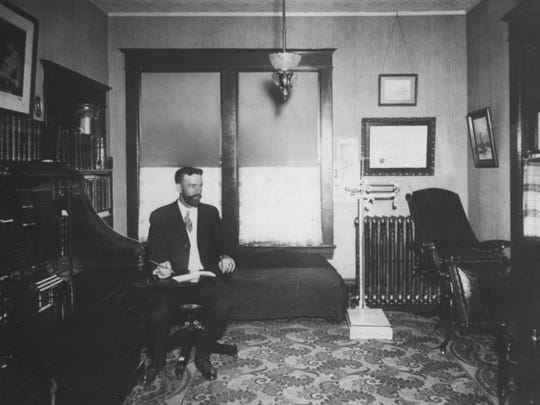 Dr. Luman Holcombe is shown here in his home office on Main Street about 1903. He practiced in Milton from 1894 until 1948. Many doctors, in addition to seeing patients in their home offices, also commonly made house calls. Holcombe held the world record in 1904 for saving an infant who was born 100 days premature, weighing 11/2 pounds. The baby girl ended up living a long and healthy life. A replica of the homemade incubator can be seen at the Milton Historical Museum.
