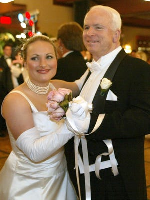 Sen. John McCain (right) shares a dance with his daughter Meghan McCain during the Board of Visitors Debutante Ball at Camelback Inn in Phoenix on April 5, 2003.
