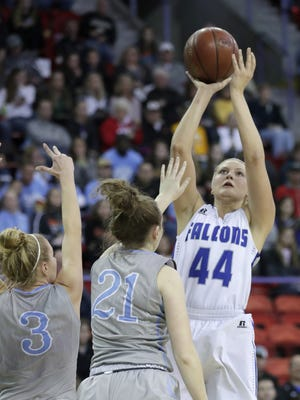 Amherst's Heather Pearson takes a jump shot  against Saint Thomas More during last week's WIAA Division 3 girls basketball state semifinal matchup. Pearson was a unanimous selection to the Wisconsin Basketball Coaches Association Division 3 all-state team.